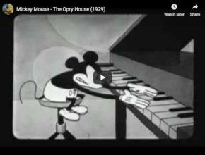 Misckey is trying to play Rachmaninov and Liszt in a 1929 cartoon, the first one with Mickey's gloves.