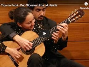 The Siqueira Lima Duo is playing Tico-Tico no Fubá at four hands on a guitar