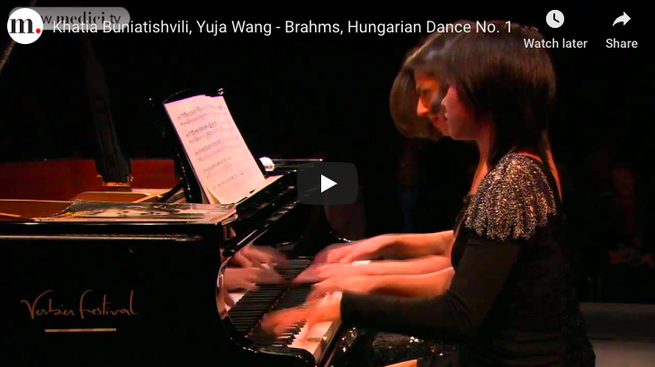 The pianist Yuja Wang and Khatia Buniatishvilli are performing Brahms' first Hungarian Dance.